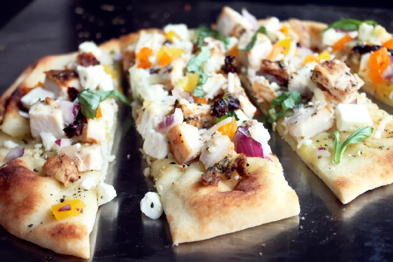 Top the pizza with the grilled chicken, mozzarella and feta cheeses ...