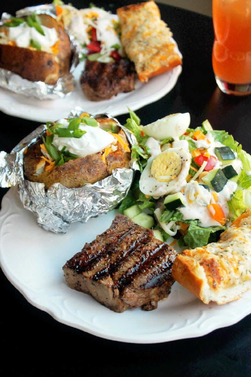 Steak House Dinner with Grilled Beef Tenderloin, Loaded Stuffed Baked Potato, Garlic Cheese Bread, and Chopped Salad with Homemade Buttermilk Ranch Dressing