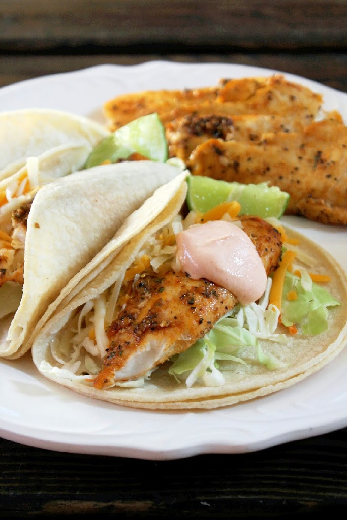 Grilled fish tacos with sriracha sour cream for Grilled white fish recipes